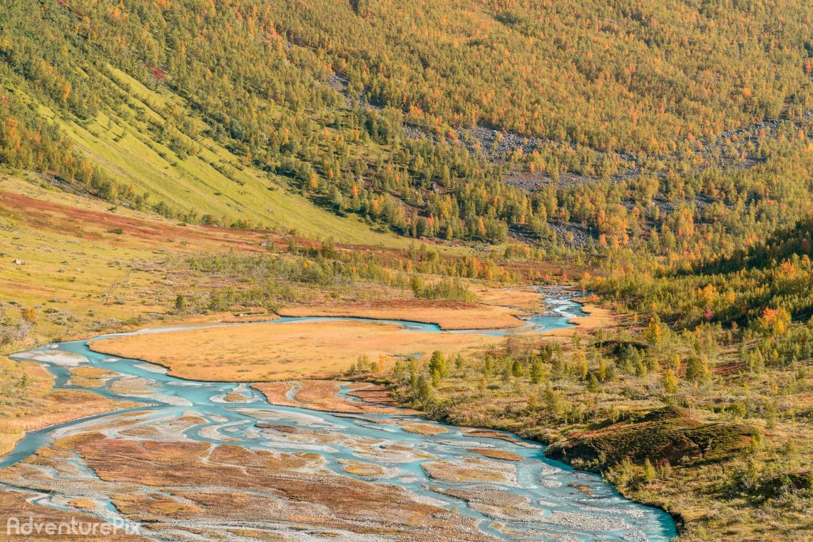 Blue glacier river in autum valley